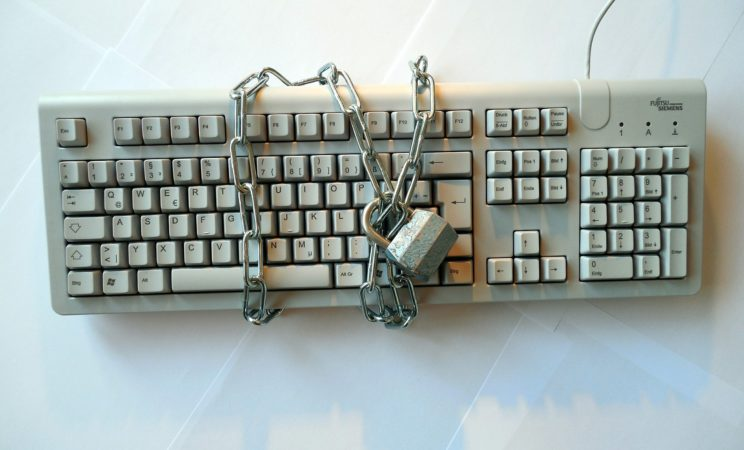 www.alberta-writer.com/blog image of a keyboard with a lock around it representing the potential of keywords The Alberta Writer Red Deer
